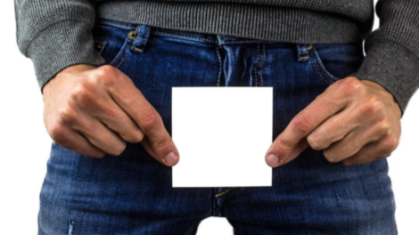 man holding white paper on jeans